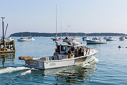 The lobster boat, 'Redeemed' at the Spruce Head Fisherman's Co-op in South Thomaston, Maine.