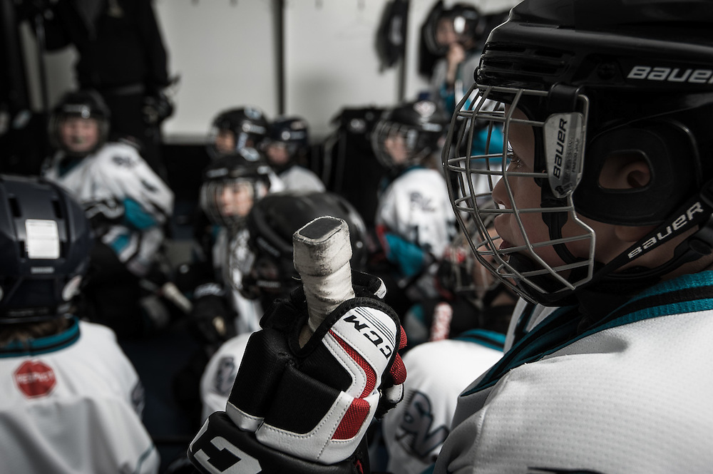 Advertising photography for REC Media promoting their advertising locations.  own Boys listening to their hockey coach in the locker room before an ice hockey game.<br /> Agency: REC Media<br /> Art Director: Tyler Quaife<br /> Photography: Brett Gilmour