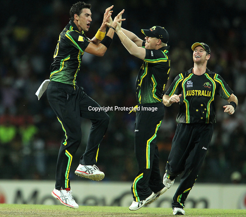Mitchell Starc, David Warner and Dan Christian celebrate the wicket of Rohit Sharma during the ICC World Twenty20 Super 8s match between Australia and India held at the Premadasa Stadium in Colombo, Sri Lanka on the 28th September 2012<br /> <br /> Photo by Ron Gaunt/SPORTZPICS