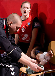 Injured Ana Gros (R) of Krim with physiotherapist Matej Cescutti at handball match of Round 3 of Champions League between RK Krim Mercator and Hypo Niederosterreich, on November 8, 2009, in Arena Kodeljevo, Ljubljana, Slovenia.  Krim won 35:24. (Photo by Vid Ponikvar / Sportida)