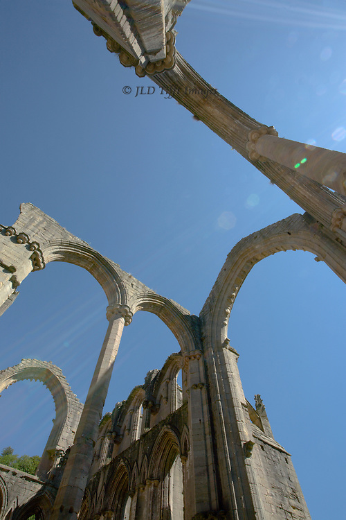 Yorkshire, Fountains Abbey ruins, looking up at the bare ruined choirs and empty arches