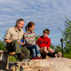 A couple and their son near the summit of Mount Agamenticus in York, Maine.