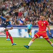 PARIS, FRANCE - September 10:   Kingsley Coman #11 of France shoots as Marc Vales #3 of Andorra attempts to block the shot during the France V Andorra, UEFA European Championship 2020 Qualifying match at Stade de France on September 10th 2019 in Paris, France (Photo by Tim Clayton/Corbis via Getty Images)