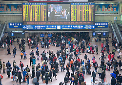 Crowds of travellers make their way home for Chinese New Year January 2009 at Beijing West Raiway Station 2009