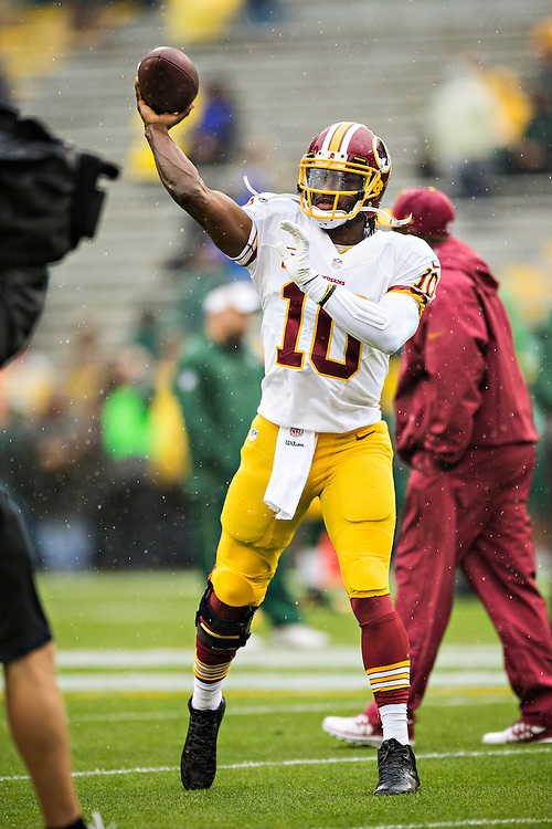 GREEN BAY, WI - SEPTEMBER 15:  Robert Griffin III #10 of the Washington Redskins warms up before a game against the Green Bay Packers at Lambeau Field on September 15, 2013 in Green Bay, Wisconsin. The Packers defeated the Redskins 38-20.  (Photo by Wesley Hitt/Getty Images) *** Local Caption *** Robert Griffin III