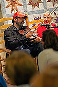 Brett Ratliff fiddles for the crowd attending the Appalachian Food Summit in Hindman, Kentucky.