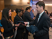 Dr. Andrew Houlihan, right, hands out hats to Houston ISD highly effectve teachers during a principal meeting, March 5, 2014.