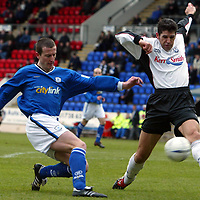 St Johnstone v Ayr United...14.02.04<br />David Craig tries to block Chris Hay's shot at goal<br /><br />Picture by Graeme Hart.<br />Copyright Perthshire Picture Agency<br />Tel: 01738 623350  Mobile: 07990 594431