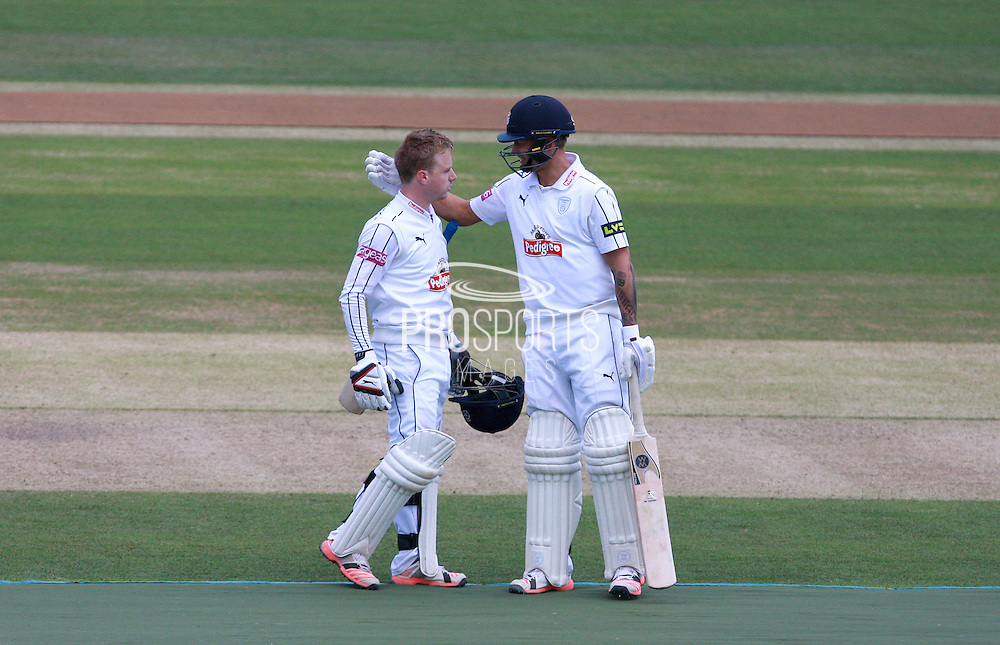 Hampshire batsman Adam Wheater is congratulated by Gareth Berg on reaching his century during the LV County Championship Div 1 match between Sussex County Cricket Club and Hampshire County Cricket Club at the BrightonandHoveJobs.com County Ground, Hove, United Kingdom on 8 June 2015. Photo by Bennett Dean.