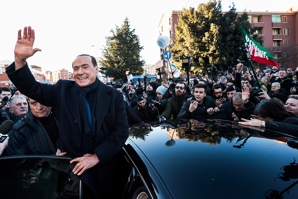 Milan, Italy - 16-01-2016: Former prime minister of Italy and President of the political party 'Forza Italia', Silvio Berlusconi, waves from his car as he leaves a public meeting in Via Forze Armate.