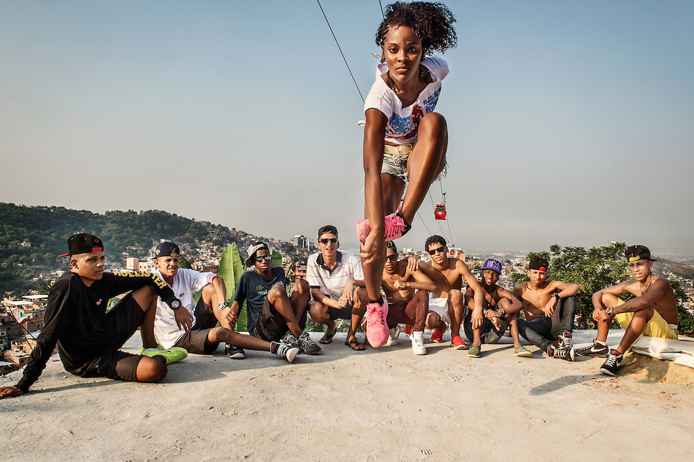 "Marcelly ""Miss Passista"". Rehearsal of the show ""Na Batalha"" on a rooftop of the Complexo do Alemão favelas. Elite dancers of the ""Passinho"" (little step) the newest dance fever that came out the Baile Funk culture. Marcelly is from the favela Morro dos Macacos"