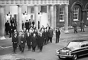 Funeral of President Childers.    (H62)..1974..20.11.1974..11.20.1974..20th November 1974..Following a period of lying in state, the remains of President Erskine Childers were removed today from Dublin Castle. The cortege would transfer the president to St Patrick's Cathedral where the funeral service would be held...Photograph shows family,ministers of state and government ministers standing as the car containing Mrs Childers passes.