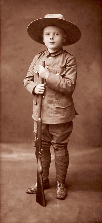 "Boy with uniform and rifle ""Young Canada, 1903"""