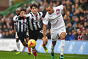 Curtis Weston Barnet FC midfielder (8) and Grimsby Town defender Zak Mills (12)    during the EFL Sky Bet League 2 match between Grimsby Town FC and Barnet at Blundell Park, Grimsby, United Kingdom on 12 November 2016. Photo by Ian Lyall.