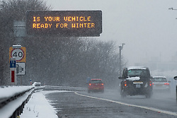 """©  London News Pictures. 18/01/2013. London, UK. A road sign on the M4 between junction 2 and 3 which reads """"IS YOUR VEHICLE READY FOR WINTER"""".  A blanket of snow is due to cover the UK causing major travel disruption. Photo credit : Ben Cawthra/LNP"""