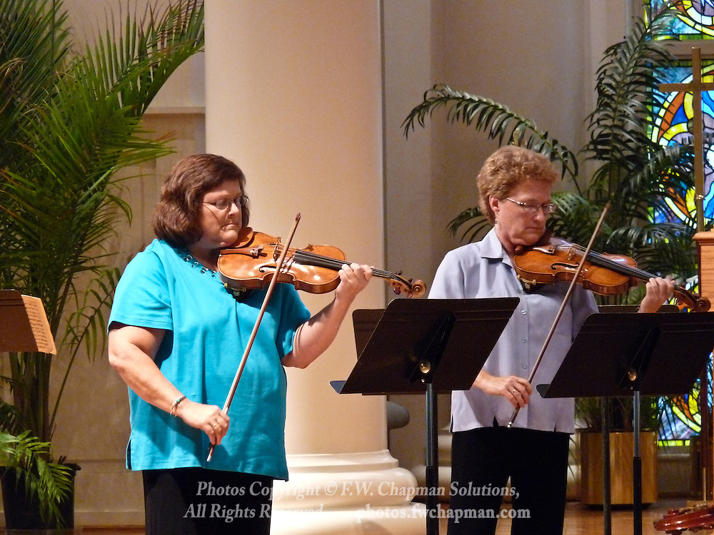 Valley Vivaldi violinists Mary Ogletree (left) and Rebecca Brown (right) perform in a Sunday evening concert starting at 7:30 PM on July 19, 2009 at Wesley Church in Bethlehem, Pennsylvania, USA.