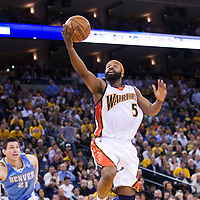 10 April 2008: #5 Baron Davis of the Golden State Warriors goes for the layup during the Denver Nuggets 114-105 victory over the Golden State Warriors at the Oracle Arena in Oakland, CA.
