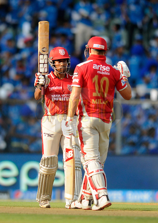 Wriddhiman Saha of the Kings X1 Punjab raises his bat after scoring a half century during match 22 of the Pepsi Indian Premier League Season 2014 between the Mumbai Indians and the Kings XI Punjab held at the Wankhede Cricket Stadium, Mumbai, India on the 3rd May  2014<br /> <br /> Photo by Pal Pillai / IPL / SPORTZPICS<br /> <br /> <br /> <br /> Image use subject to terms and conditions which can be found here:  http://sportzpics.photoshelter.com/gallery/Pepsi-IPL-Image-terms-and-conditions/G00004VW1IVJ.gB0/C0000TScjhBM6ikg