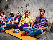 09 SEPTEMBER 2016 - BANGKOK, THAILAND:  Protesters who support the residents of the Pom Mahakan slum sit against the old city walls in the historic fort. Forty-four families still live in the Pom Mahakan Fort community. The city of Bangkok has given them provisional permission to stay, but city officials say the permission could be rescinded and the city go ahead with the evictions. The residents of the historic fort have barricaded most of the gates into the fort and are joined every day by community activists from around Bangkok who support their efforts to stay. Supporters of the residents come into the fort everyday in case the city tries again to evict the residents.            PHOTO BY JACK KURTZ