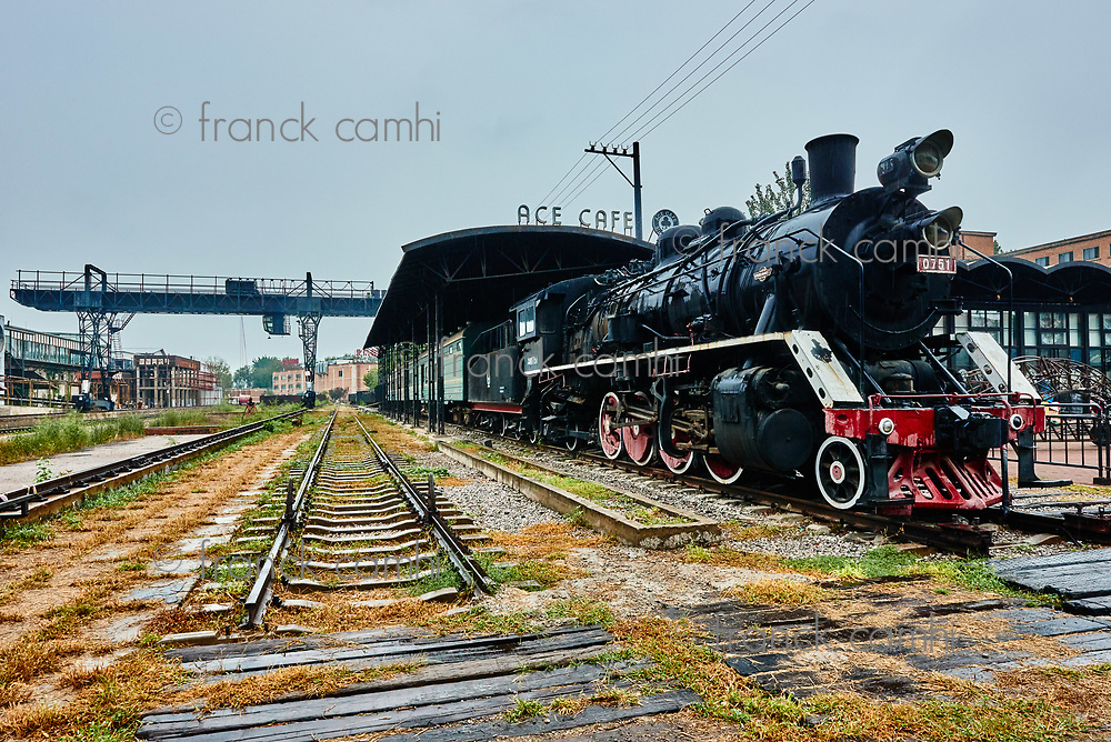 Beijing , China - September 23, 2014 : ancient train steam engine of AT CAFE  of the  798 Art District zone aera in Beijing China