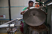 At the modern factory of P.T.C Agro an hour east of Colombo cinnamon flakes are distilled to produce extremely high quality cinnamon oil that they export abroad.