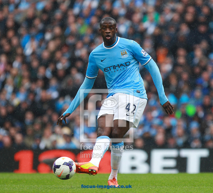 Yaya Toure of Manchester City during the Barclays Premier League match at the Etihad Stadium, Manchester<br /> Picture by John Rainford/Focus Images Ltd +44 7506 538356<br /> 11/05/2014