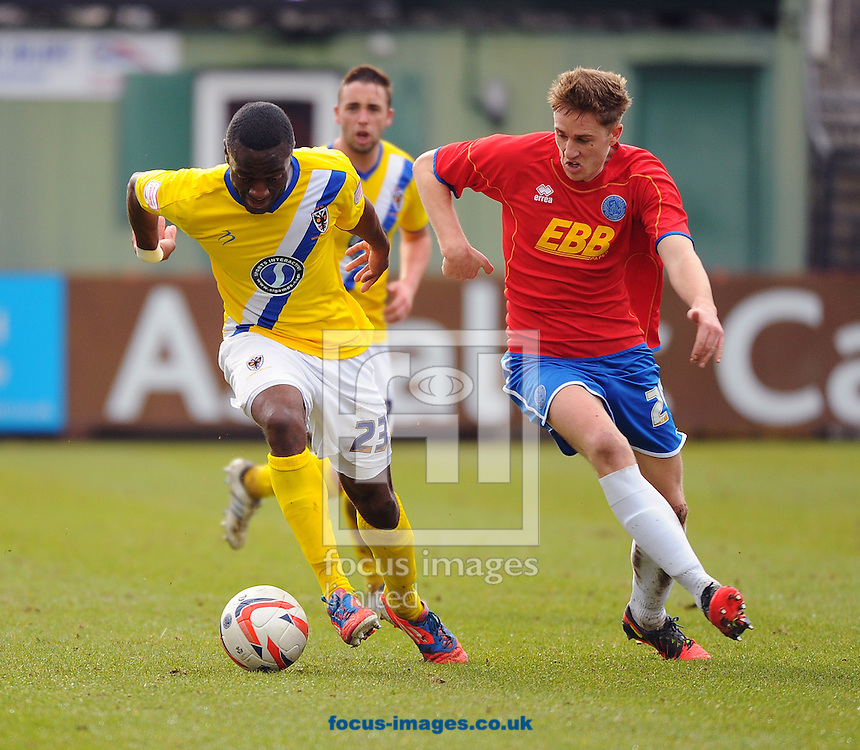 Picture by Seb Daly/Focus Images Ltd +447738 614630.16/03/2013.Asa Hall of Aldershot Town and Rashid Youssouf  of AFC Wimbledon during the npower League 2 match at the EBB Stadium, Aldershot.