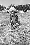 Billy sitting down in a field, Glastonbury, Somerset, 1989