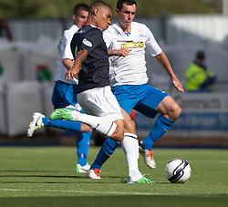Falkirk's Phil Roberts scoring their third goal.<br /> Falkirk 3 v 1 Morton, Scottish Championship 17/8/2013.<br /> &copy;Michael Schofield.