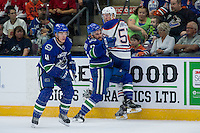 PENTICTON, CANADA - SEPTEMBER 16: Yan-Pavel Laplante #74 of Vancouver Canucks checks Collin Shirley #57 of Edmonton Oilers on September 16, 2016 at the South Okanagan Event Centre in Penticton, British Columbia, Canada.  (Photo by Marissa Baecker/Shoot the Breeze)  *** Local Caption *** Yan-Pavel Laplante; Collin Shirley;
