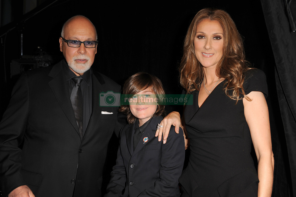 MIAMI BEACH, FL- FEBRUARY 16: Celine Dion (AKA Céline Marie Claudette Dion)  arrives with her husband Rene Angelil (her manager, Syrian ancestry, m. 17-Dec-1994, one son)  and her son Rene-Charles Angelil (b. 25-Jan-2001) at the world premier of ''Celine Through The Eyes Of The World movie at the Regal South Beach Cinema. On February 16, 2010 Miami Beach, Florida...People:  Celine Dion, Rene Angelil, Rene-Charles Angelil. (Credit Image: © SMG via ZUMA Wire)