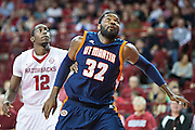 FAYETTEVILLE, AR - DECEMBER 19:  Pierre Mopo #32 of the UT Martin Skyhawks goes for a rebound against the Arkansas Razorbacks at Bud Walton Arena on December 19, 2013 in Fayetteville, Arkansas.  The Razorbacks defeated the Skyhawks 102-56.  (Photo by Wesley Hitt/Getty Images) *** Local Caption *** Pierre Mopo