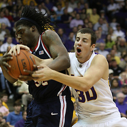 14 February 2009 DeAundre Cranston (52) of Ole Miss fights with LSU guard Alex Farrer (30) over a rebound during 73-66 win by the LSU Tigers against SEC rival the Ole Miss Rebels at the Pete Maravich Assembly Center in Baton Rouge, LA.