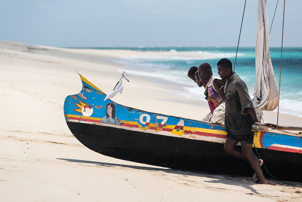In a timeless custom, fishermen help each other to pull a sailing canoe up from the surf onto the sandbar they are living on.  In the remote islands, there is a strong sense of community among migrants - essential when rough seas can trap them far offshore with no drinking water and food.  The government of Madagascar and Blue Ventures (a marine conservation NGO) are working with traditional fishers here to create a community-managed marine protected area.  By giving small-scale fishers strong management rights, there is the chance that fisheries wil bounce back and even become profitable again.