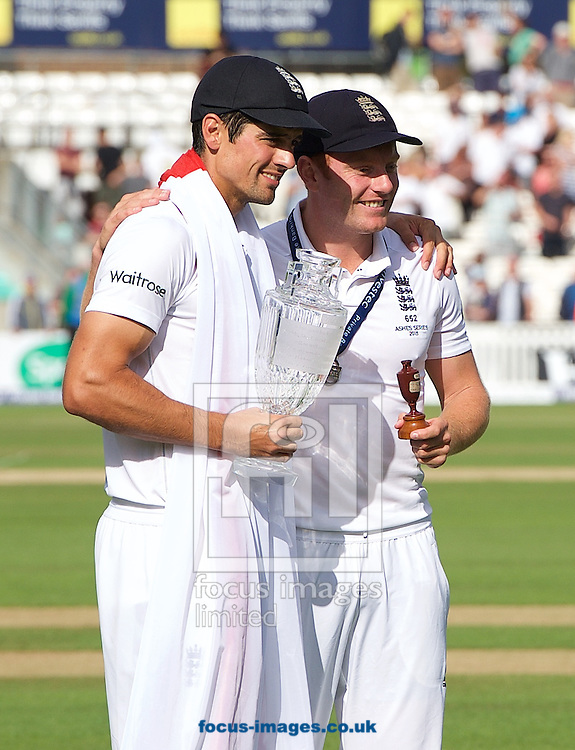 Captain Alastair Cook (left) of England with the trophy and  Jonny Bairstow with the Ashes Urn after winning the Ashes test series during the 5th Investec Ashes Test match at the Kia Oval, London<br /> Picture by Alan Stanford/Focus Images Ltd +44 7915 056117<br /> 23/08/2015