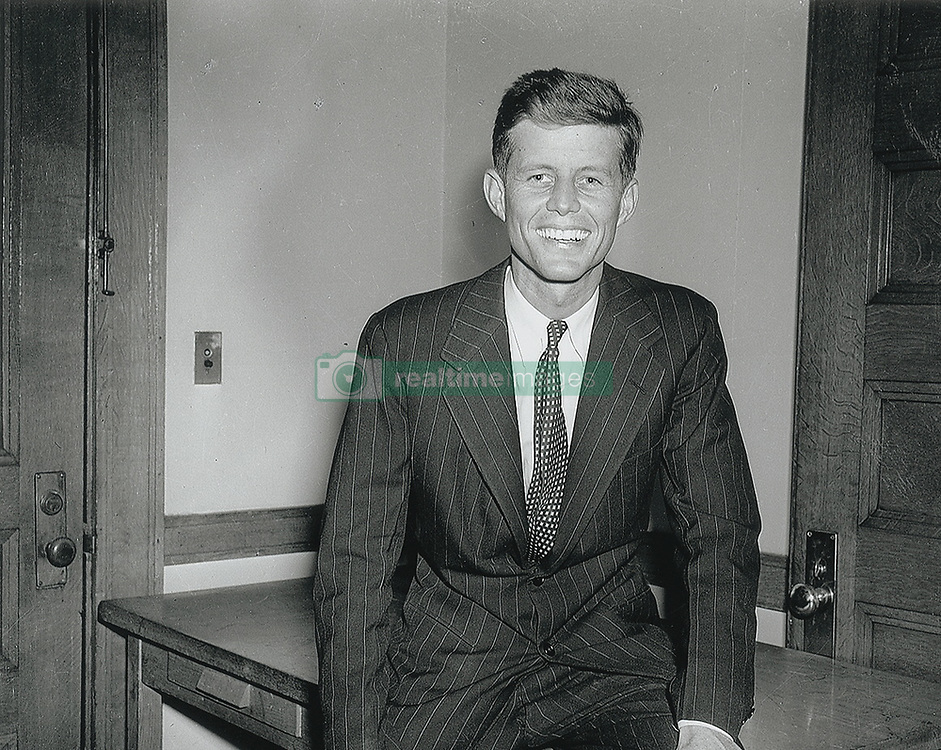 John F. Kennedy, the nation's 35th President, would have turned 100 years old on May 29, 2017. With the centennial anniversary of John F. Kennedy's birth, the former president's legacy is being celebrated across the nation. PICTURED: U.S. - File Photo - JOHN F. KENNEDY seated on a desk inside his Beacon Hill apartment, taken as one of the first 'official' portrait photographs to be used for his 1952 Senatorial campaign. In very fine museum-quality condition. A delightful image featuring an incredibly casual and rudimentary backdrop for 'official' photographs. John F. Kennedy wearing a striped suit and sitting on a table in his Beacon Hill apartment. This image was used as an 'official' portrait photograph for Kennedy's 1952 senatorial campaign. In very fine museum-quality condition. A striking portrait photograph of the future senator using his apartment as a backdrop for these photographs as he previously did in 1946 during his congressional campaign. In commemoration of JFK's 100th birthday on May 29, 2017, RR Auction has curated an once-in-a-lifetime assortment of Kennedy artifacts, signed material, and photographs to celebrate the life of America's beloved 35th president. The more than 175 lots cover; JFK's early years, the transition to his congressional and senatorial careers, and 'The 1,000 Days of Camelot,' Kennedy's storied tenure as president. The special online offering is scheduled to begin on May 11 and will conclude on May 18, 2017. The R. Paloger photographs shows a period in JFK's life from 1946 to 1953, chronicling JFK's first political congressional campaign of 1946, his run for U.S. senator in 1952, and his marriage to Jackie in 1953. (Credit Image: © Ronnie Paloger/RR Auction via ZUMA Wire/ZUMAPRESS.com)