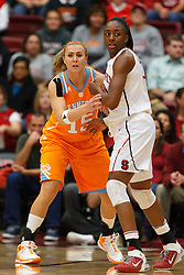 Dec 20, 2011; Stanford CA, USA;  Stanford Cardinal forward Nnemkadi Ogwumike (30) is defended by Tennessee Lady Volunteers forward Alicia Manning (15) during the first half at Maples Pavilion.  Stanford defeated Tennessee 97-80. Mandatory Credit: Jason O. Watson-US PRESSWIRE