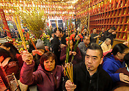 People with incense and flowers crowd at the Thien Hau temple to celebrate the first day of the Chinese Lunar New Year, the Year of the Dog, on Friday February 16, 2018, in Los Angeles, the United States. (Xinhua/Zhao Hanrong)<br /> 2月16日,农历正月初一凌晨,在美国洛杉矶,大批华人涌入中国城天后宫庙上香祈福。图为民众在庙內进香。新华社发 (赵汉荣摄) (Photo by Ringo Chiu)<br /> <br /> Usage Notes: This content is intended for editorial use only. For other uses, additional clearances may be required.