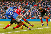 Lassana Coulibaly is forced of the ball by Kirk Broadfoot of Kilmarnock during the Ladbrokes Scottish Premiership match between Rangers and Kilmarnock at Ibrox, Glasgow, Scotland on 16 March 2019.