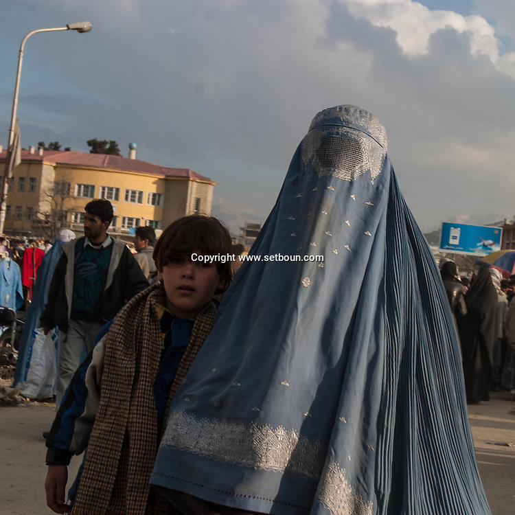 Afghanistan. Kabul. women in burqua , city center street life