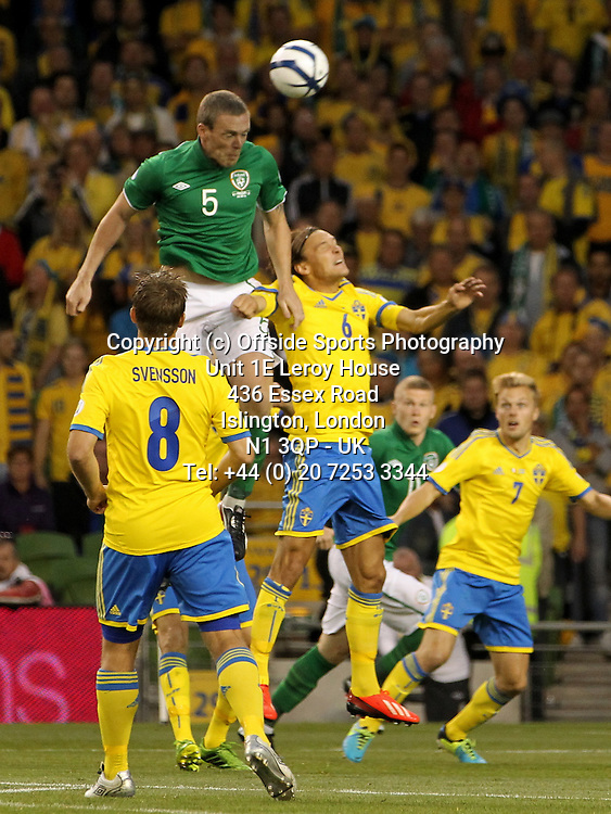 06/09/2013 FIFA 2014 World Cup Qualifying - Group C . Rep of Ireland v Sweden<br /> Richard Dunne head the ball away from Albin Ekdal<br /> Photo: John Halas