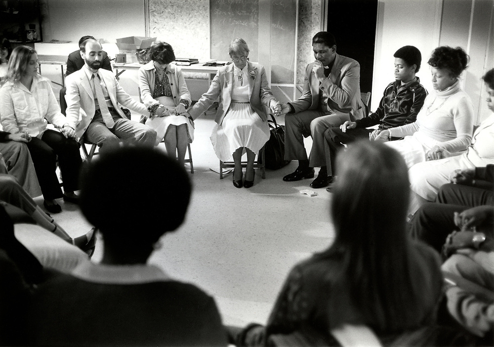 Psychic Roberta Chadwick - in center with white skirt, jacket and glasses - with members of Atlanta's clergy as they meditate on the Atlanta Child Murders at Atlanta's Hillside Church in 1981. Some thought that Ms. Chadwick could reveal the killer or his location through physic intervention.