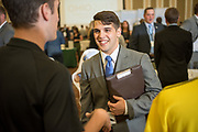Students interact with employers at that the Darren Butler Sports Business Forum career fair. Photo by Ben Siegel