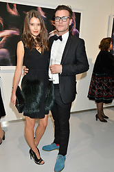 SARAH ANN MACKLIN and FREDDIE WATERS at a private view of Dancing Away featuring work by Mikhail Baryshnikov held at ContiniArtUK, 105 New Bond Street, London on 27th November 2014.