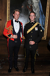 Left to right, CAPTAIN CHARLES PEARSON and CAPTAIN RICHARD DENSHAM at a dinner in aid of Caring For Courage - The Royal Scots Dragoon Guards Afghanistan Welfare Appeal held at The Royal Hospital Chelsea, London SW3 on 20th October 2011.