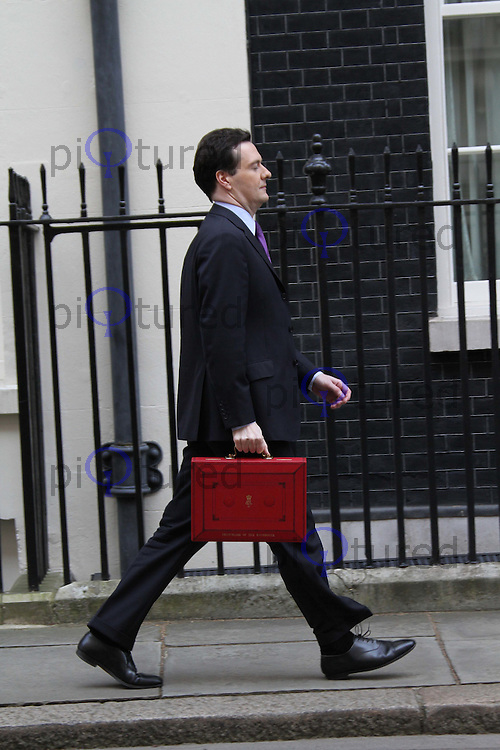 Chancellor of the Exchequer George Osborne presents the Budget despatch box at 11 Downing Street, London, UK, 23 March 2011:  Contact: Rich@Piqtured.com +44(0)7941 079620 (Picture by Richard Goldschmidt)