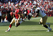SAN FRANCISCO - SEPTEMBER 17:  Quarterback Alex Smith #11 of the San Francisco 49ers rolls out for positive yardage while avoiding a tackle by Leonard Little #91 of the St. Louis Rams at Monster Park on September 17, 2006 in San Francisco, California. The Niners defeated the Rams 20-13. ©Paul Anthony Spinelli *** Local Caption *** Alex Smith;Leonard Little