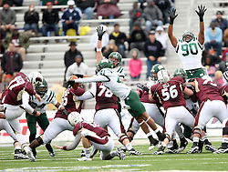 Ohio defensive back Tre Hunter blocks a field goal attempt from Louisiana-Monroe kicker Justin Manton Advocare V100 Independence Bowl NCAA college football game, Friday, Dec. 28, 2012, in Shreveport, La.