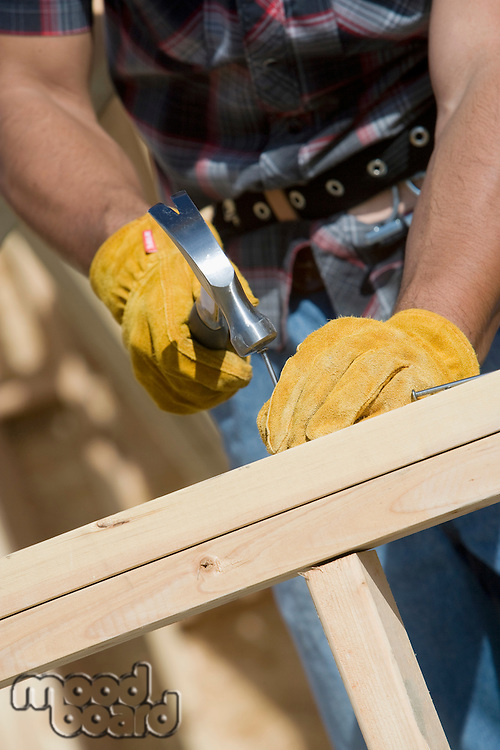 Construction worker using hammer, close-up