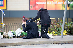 © Licensed to London News Pictures. 22/12/2017. Skipton UK. A woman breaks down in tears at the scene where a 30 year old woman has died after she was stabbed in an Aldi supermarket in Skipton. North Yorkshire Police have arrested a 44 year old man on suspicion of murder following the attack shortly before 3:30 pm on Thursday. Photo credit: Andrew McCaren/LNP